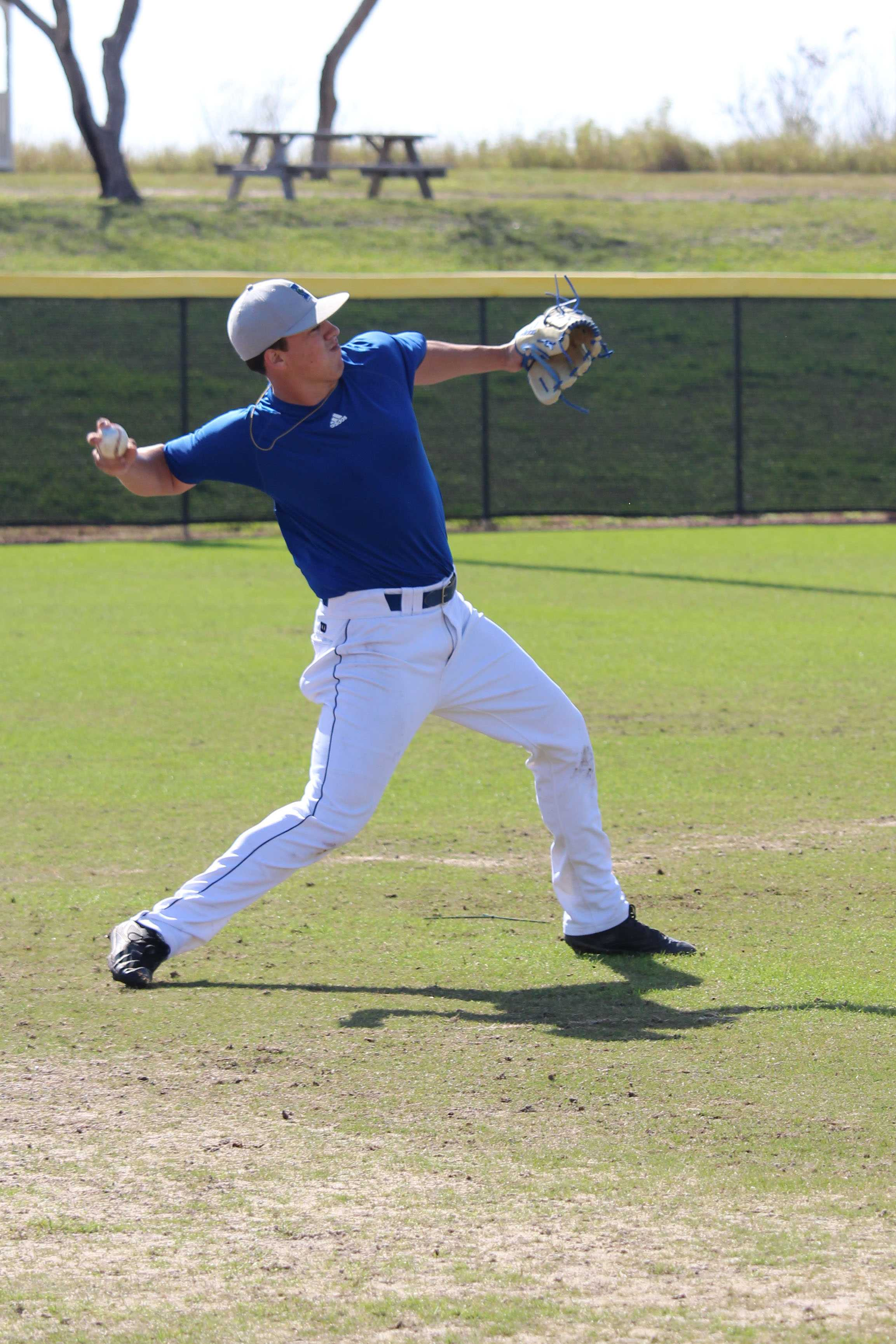 Photo by Jonathan Forney/ Island Waves  Junior pitcher Aaron Hernandez looks to make  an impact.