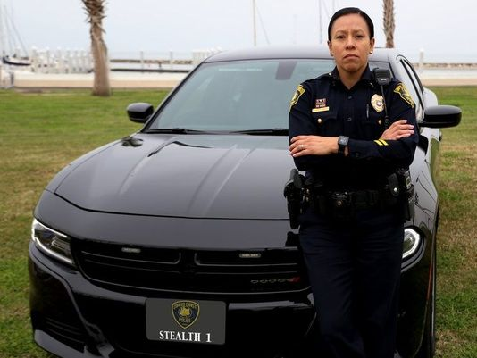 A CCPD officer stands in front of a stealth car. Image courtesy of the Caller Times.