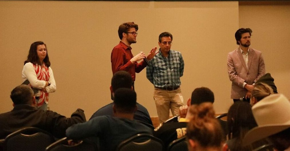 P1: Dr. Shane Gleason (middle left) and Dr. Juan Carlos Huerta (middle right) Leading Post Debate Discussions. Photo by Arianna Aloia