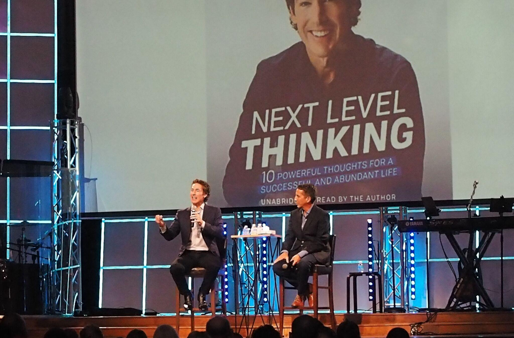 Joel Osteen (left) speaks to Pastor Steve Coronado at the Solid Rock Church about his book