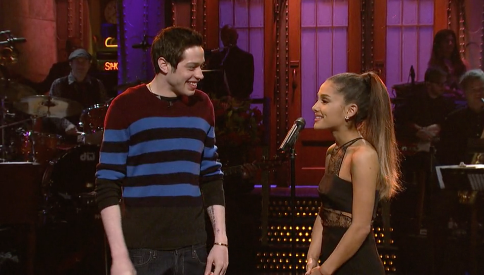 "Ariana Grande (right) and Pete Davidson (left) when she first hosted ""Saturday Night Live"" where Davidson works as an actor. Shortly after, at the after party, the two were seen ""very flirty and friendly,"" Davidson keeping his arm around Grande. Source: https://www.seventeen.com/celebrity/celebrity-couples/a21285444/ariana-grande-pete-davidson-relationship-timeline/"
