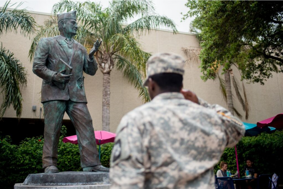 A+Miltary+soldier+salutes+the+statue+of+Hector+P.+Garcia+in+the+Plaza+decicated+to+him+on+TAMU-CC+Campus+in+honor+of+his+service.+