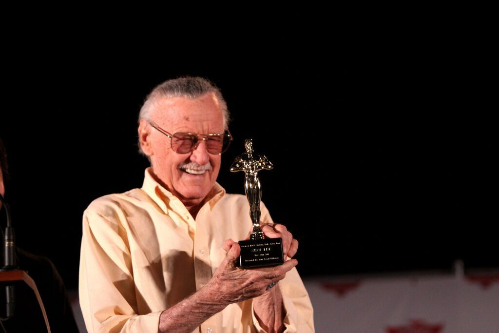 "Image courtesy of Wikimedia Commons Stan Lee at Phoenix Comicon 2011 in Arizona, receiving ""Best Cameo"" award."