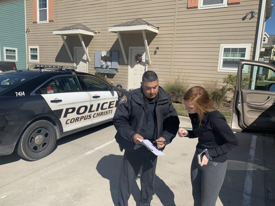 CCPD Officer Reyos speaks with a theft victim.