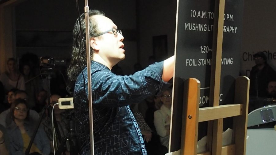 Weil Gallery 6-8 pm, March 20, Photos by Jonathan Garcia/Island Waves Chin-Cheng Hung draws a sketch with pastel colors, explaining the differences with cool and warm tones and utilizing lighting to give the artwork more definition.