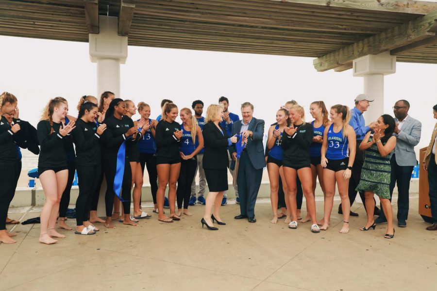 Images courtesy of Arianna Aloia/ISLAND WAVES - President Quintanilla, Mayor Joe McComb, and members of volleyball and basket teams gathered to cut the ribbon