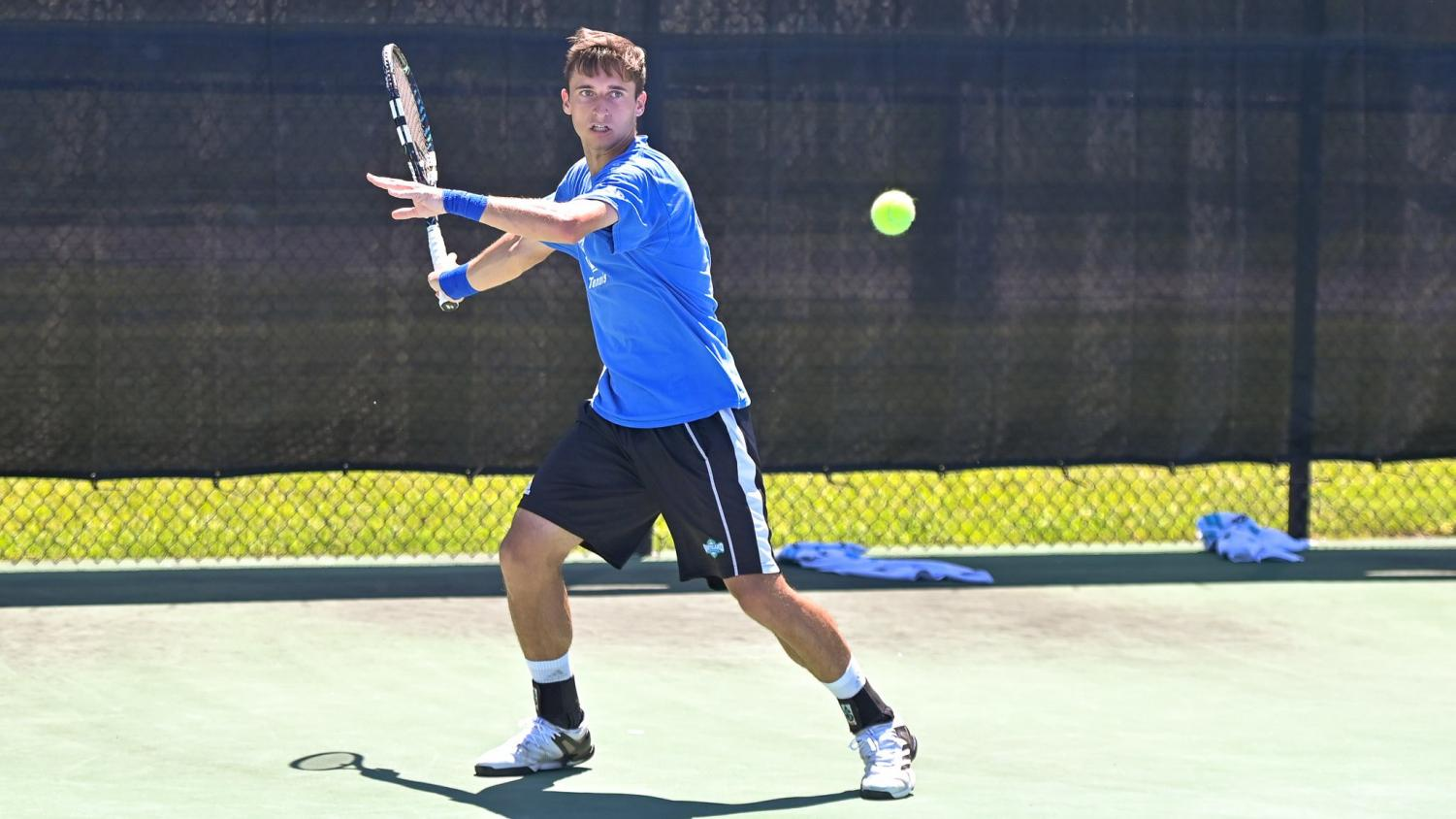 Image courtesy of Tim Hannah/Islander Athletics- Carlos Pedrosa Cuevas representing the Islanders in the men's tennis match against the University of the Incarnate Word on April 9, their first win in the Southland Conference.