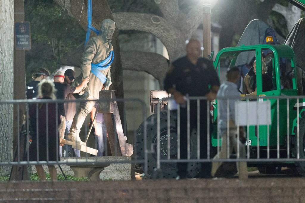 Image courtesy of Dallas Morning News UT-Austin removes confederate statues from campus during the night with police on guard.