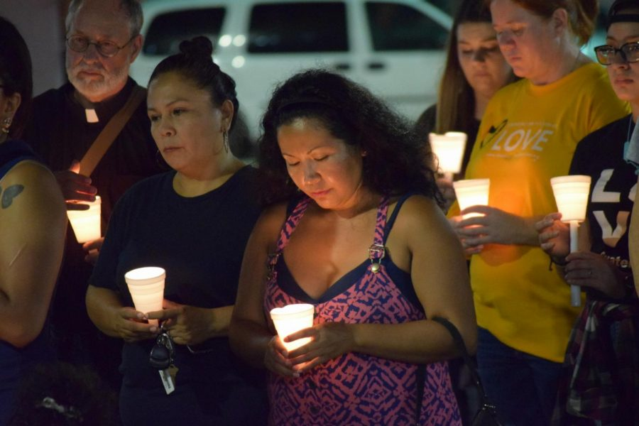 All photos credited to Raul Alonzo Jr./ISLAND WAVES/ Criselda Lugo (center) observes a moment of reflection for the victims of the Aug. 3 shootings in El Paso and Dayton on Wednesday, Aug. 7. Dozens gathered at La Retama Park for the event, meant to remember those lost but also to call for action against hate and white supremacy.