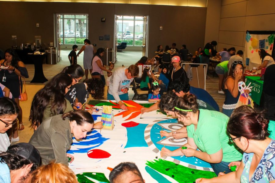Photos courtesy of ISLAND WAVES / Event attendees work hard into the evening to finish the mural.