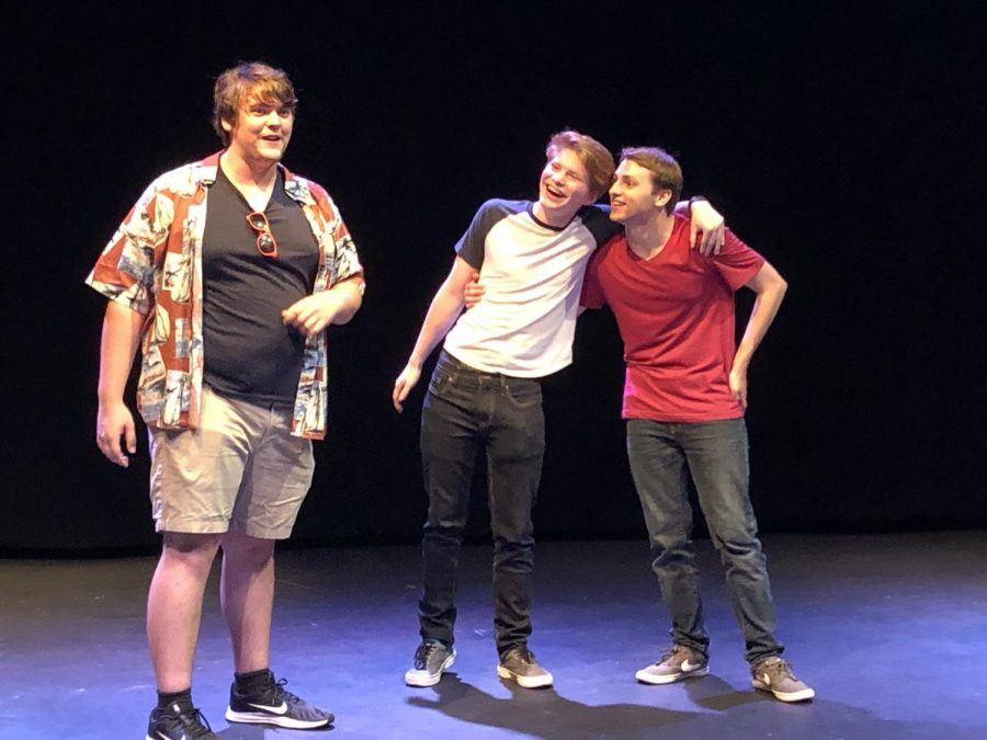 """Photos by Jonathan Garcia/Island Waves -  Mitchell Jackson explains the game of """"dumbbell races"""" as Jacob Martinez and Austin Brady link up together, playing the couple """"pantstelope,"""" a couple obsessed with wearing pants."""