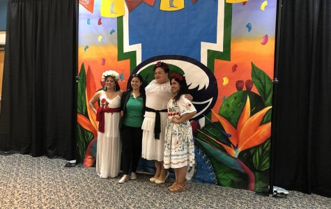 Photos by Jonathan Garcia/Island Waves- Mayra Zamora (from left), Andrea Montalvo-Hamid, Monica Garcia and Sandra Gonzalez stand for a photo with the mural.