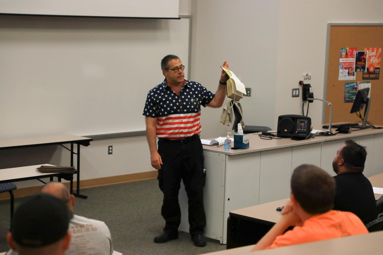Photos courtesy of Miguel Gutierrez/ISLAND WAVES -Professor Eric Moore demonstrates how short the U.S. Constitution is.