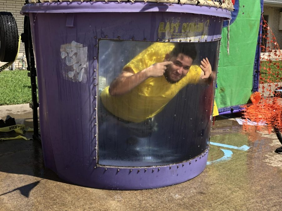 Jonathan Garcia/ISLAND WAVES - Samuel Reyes goes for a nice swim after getting dunked in the dunk tank by a festival goer at the Columbian Food Festival.