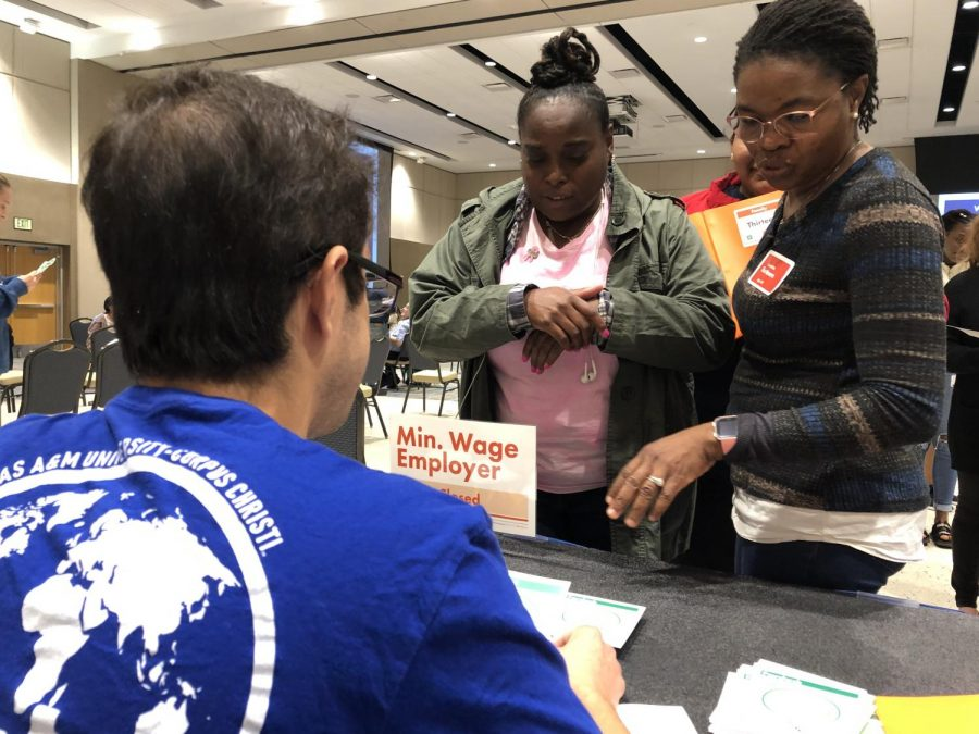 Jonathan Garcia/ISLAND WAVES- Jacquelyn Scott (left) and Nicole Aman beg the minimum wage employer for a job to get by at the Cost of Poverty Experience (COPE).