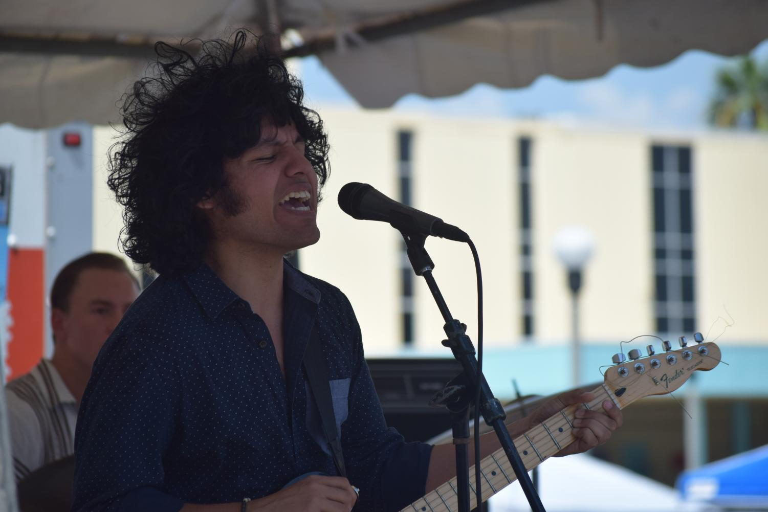 Raul Alonzo Jr./ISLAND WAVES - Jesse De Los Santos of the Blind Owls sings during their set at the ¡Que Bueno! Taco Fest this past September. The Blind Owls will be bringing their brand of high-energy rock and roll to two stages this weekend: Bourbon St. for Hippie Halloween on Friday and the Halloween Dance Party at The NASA on Saturday.