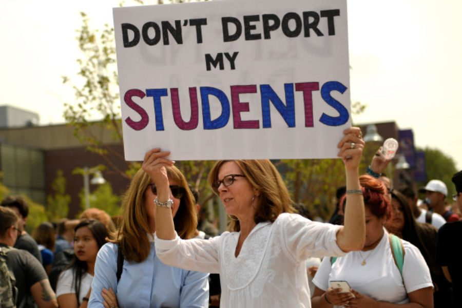 Photo courtesy of Joe Amon/The Denver Post - Randi Smith, a psychology teacher at Metro carries a sign for her students as students, immigrants and Impacted individuals marched to Tivoli Quad on Auraria Campus to defend the Deferred Action for Childhood Arrivals (DACA) program during a city wide walkout and rally at Auraria Campus downtown Denver, CO.