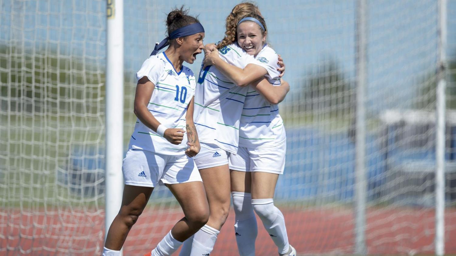Photo courtesy of Islander Athletics - Athletes, Larissa Fagundes and Kayla Gove celebrating a 1-0 victory over Northwestern State. The lady Islanders clinch a Southland Conference tournament berth with Friday's win.
