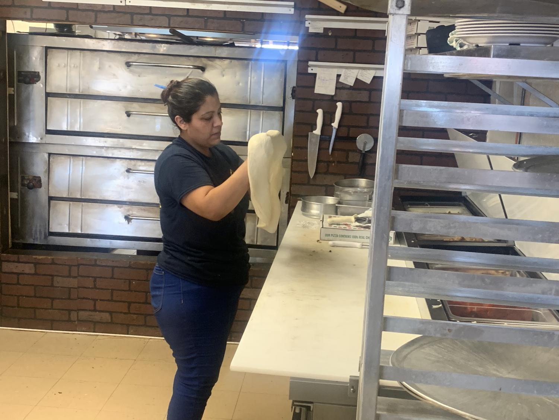 Miguel Gutierrez/ISLAND WAVES - New York Pizza Co. employee preps dough for pizza.