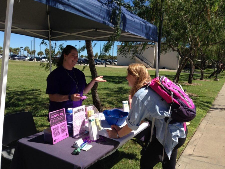Courtesy of the Counseling Center/TAMU-CC- Alison Marks explains to a student on what the pledge cards are about and informs her about bullying among the LGBT community and regular bullying.