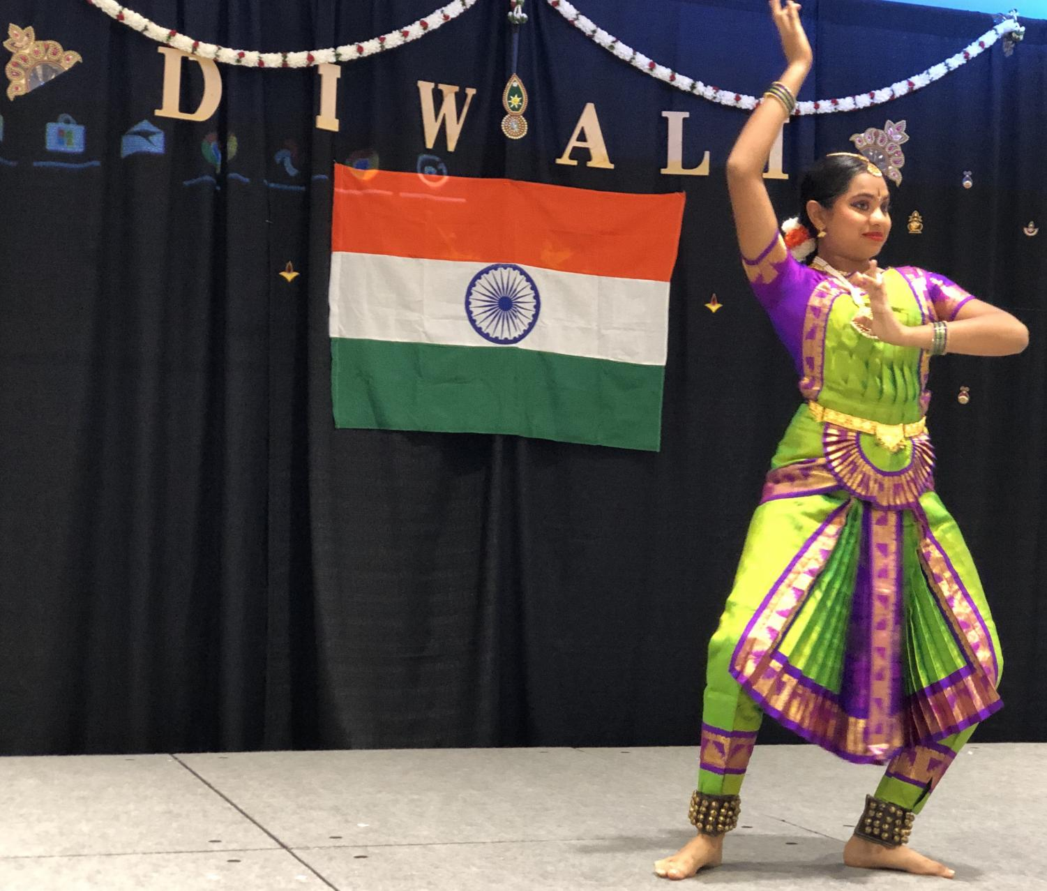 Jonathan Garcia/ISLAND WAVES - Veterans Memorial High School sophomore Sunidhi Kulkarni performs for a group of many in attendance at the Diwali festival, getting in touch with her roots.