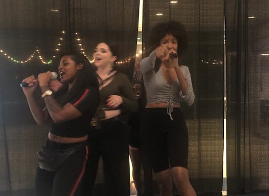 Gabriella Ruiz/ISLAND WAVES - Members of Queen Beauty Club having a good time singing to their favorite songs.
