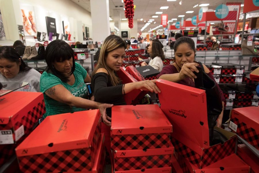 Photo archive contributed by Courtney Sacco/Corpus Christi Caller-Times (Photo featured on New York Times Article on Nov. 23, 2017) Nytimes.com - Many shoppers browsing through shoes getting a great price on them at JCPenney which will be open during Black Friday on Nov. 29.