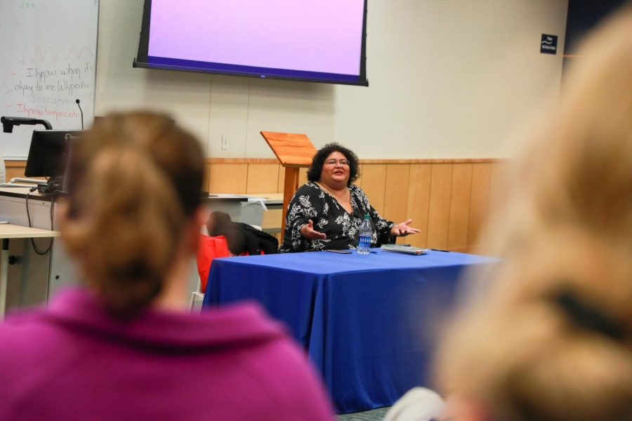 ire'ne lara silva speaks to attendees before reading from her book.
