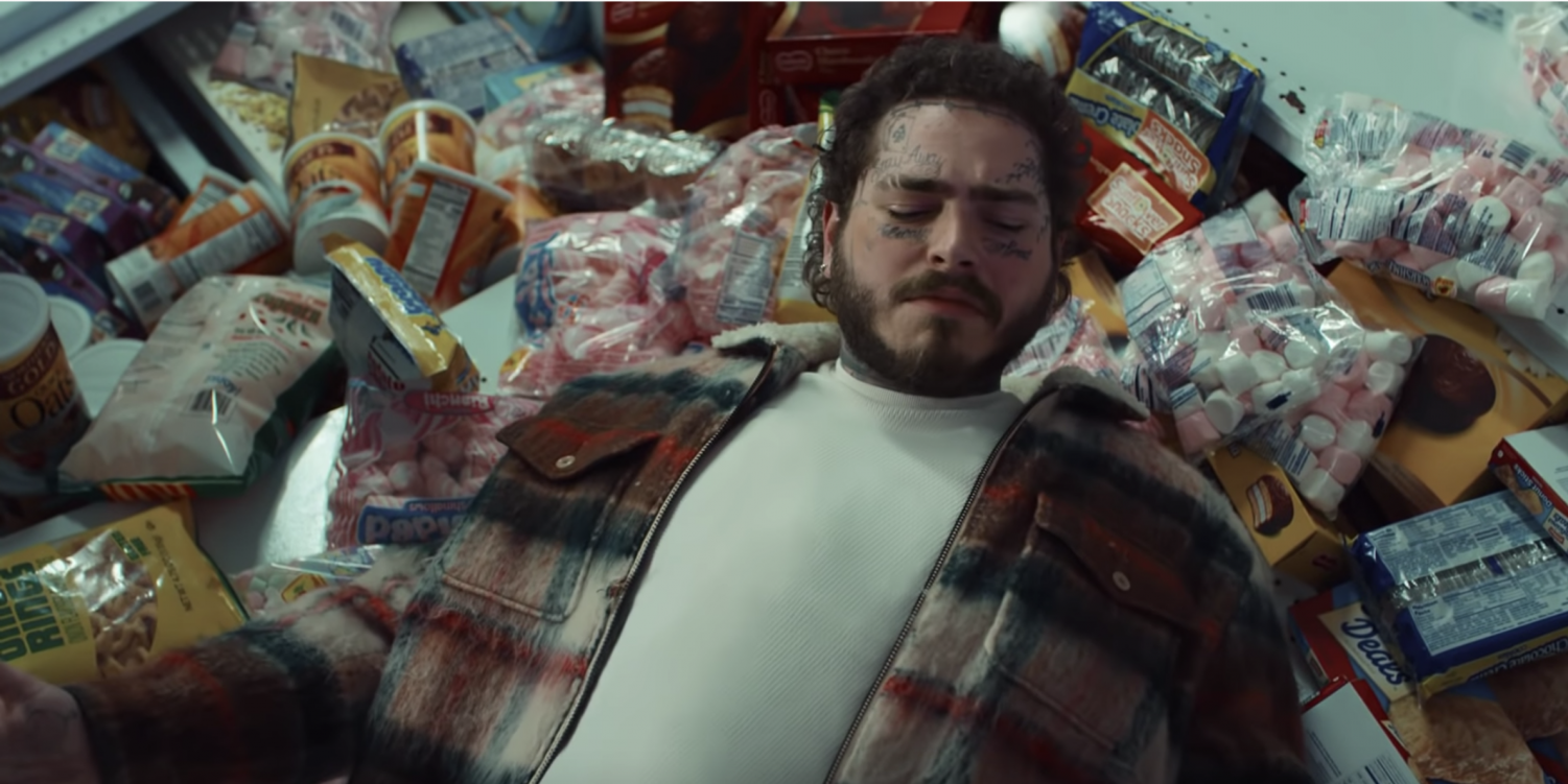 Post Malone looks confused after wreaking havoc in a convenience store.