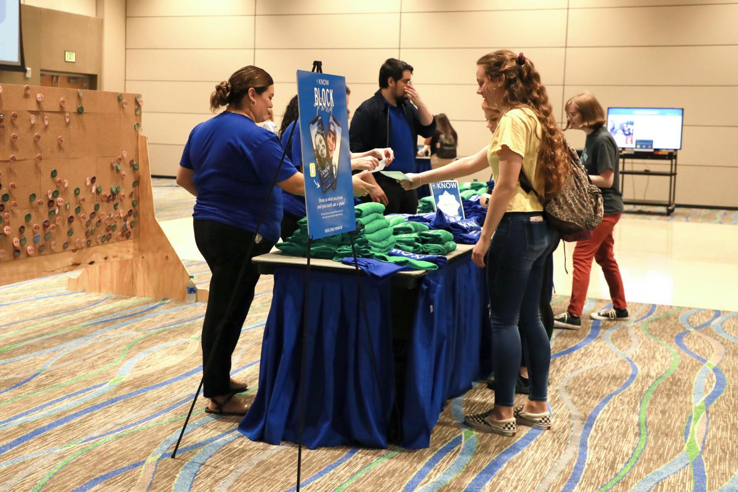Students collect buttons, T-shirts and other giveaway items at the I-Know Quality Enhancement Plan Block Party on Feb. 4.