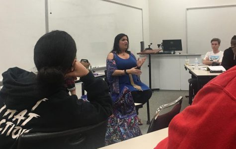 Kitana Sanchez lectures a Communication class on the LGBTQ+ community.