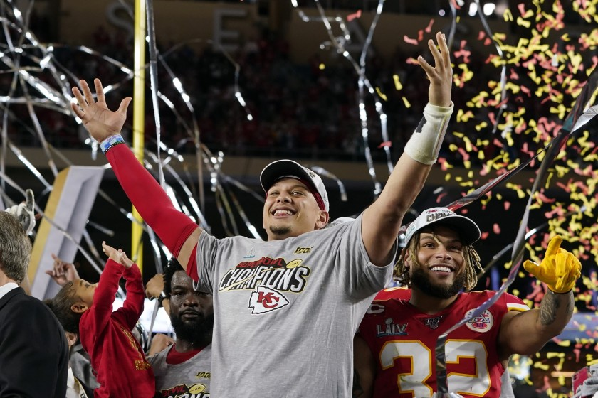 Kansas City Chiefs quarterback and Super Bowl MVP Patrick Mahomes (left) and safety Tyrann Mathieu celebrate their Super Bowl LIV victory after their last victory in 1970.