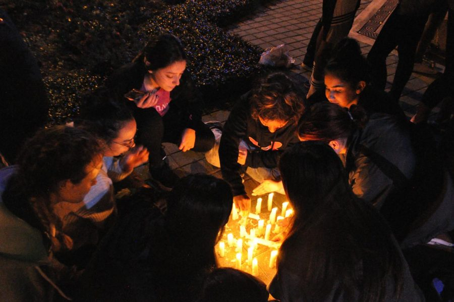 """Students gather candles, saying they are """"stronger together."""""""