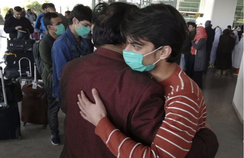 A Pakistani student arrives home at Islamabad International Airport on Feb. 3.