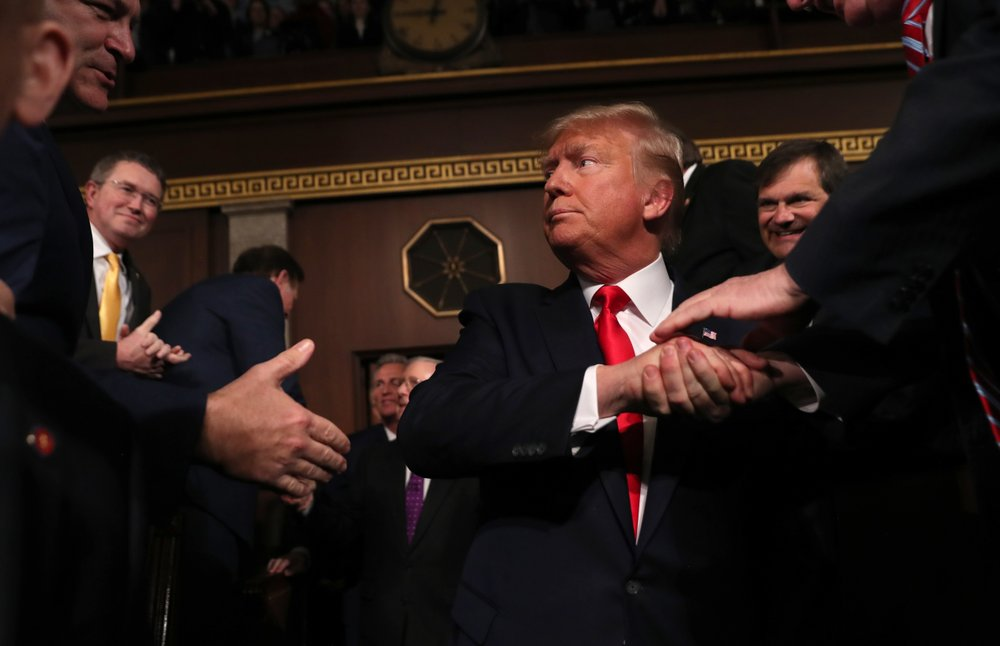 Trump shakes hands before delivering his State of the Union address on Feb. 4.