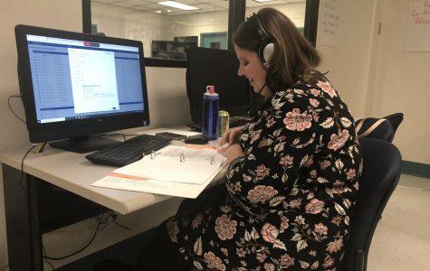 Student Activities Coordinator Stacy Rowan assists an international student over the phone at TAMU-CC's call center.