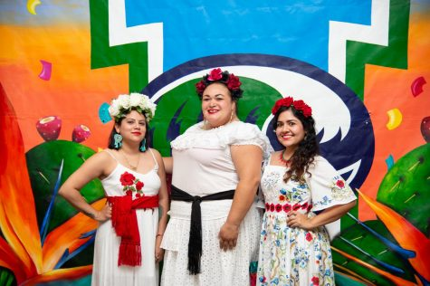 "From left to right, Mayra Zamora, Monica Marie Garcia and Sandra Gonzalez, known collectively as Las Muralistas, pose in front of their mural ""Viva TAMU-CC"" during the piece's unveiling on Sept. 27, 2019."