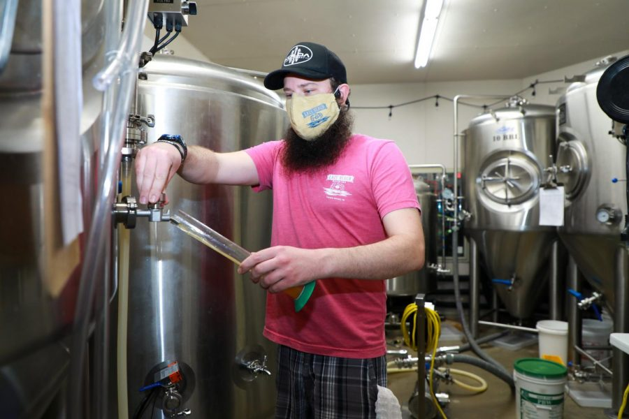 Local worker, Drew Burkhardt, taste testing a new brew for the grand opening of the cafe.