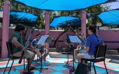 The woodwind quartet performs both classical and modern pieces with bassoons in the Hector P. Garcia Plaza.
