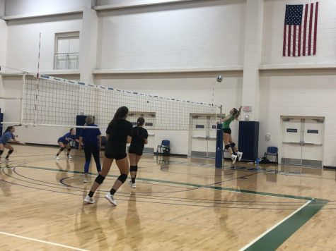 The Islanders practice their volleyball drills while preparing for their upcoming matches.